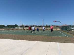 Active Adult Lifestyle Men playing basketball at OTOW